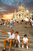 Family infront of the Basilica of the Sacred Heart of Jesus of Paris - Sacré-Coeur Basilica.