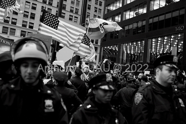 "New York, New York<br /> November 17, 2011<br /> <br /> ""Occupy Wall Street"" protesters mark the movement's two-month milestone by marching from Zuccotti Park, in mass, to various access streets surrounding the New York Stock Exchange, which the police had barricaded off. Yet instead of the police keeping protesters out, protesters locked down those entrances to Wall Street and the New York Stock Exchange creating havoc as the police made more then 240 arrests to try and keep the streets open to normal traffic.<br /> <br /> Protesters begin their march stepping off from the Harriman Foundation Square down Cedar Street towards the NYSE."