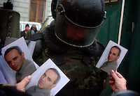 A woman carrying pictures of former world chess champion Garry Kasparov demonstrates in Moscow against what she and others felt were rigged presidential elections. The protesters are part of the United Civil Front group (part of the opposition coalition The Other Russia) led by Kasparov and writer Eduard Limonov...