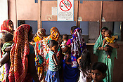 Caretakers and family workers gather  at the local health centre in Hanuman Nagar, Saptari, Nepal.
