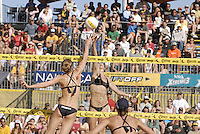 Huntington Beach, CA - 5/6/07:  Kerri Walsh spikes the ball over Nicole Branagh during May-Treanor / Walsh's 21-13, 21-13 win over Branagh / Youngs in the championship match of the AVP Cuervo Gold Crown Huntington Beach Open of the 2007 AVP Crocs Tour..Photo by Carlos Delgado