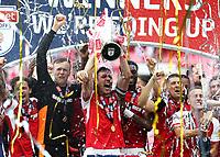 27th May 2018, Wembley Stadium, London, England;  EFL League 1 football, playoff final, Rotherham United versus Shrewsbury Town; Richard Wood of Rotherham United lifts the EFL League 1 trophy