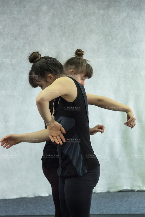 """Switzerland. Canton Ticino. Orselina. Clinica Santa Croce. MOPS_DanceSyndrome is an independent Swiss artistic, cultural and social organisation operating in the field of contemporary dance and disability. It is composed only of Down dancers. Elisabetta Montobbio (L) and Gaia Mereu (R) on stage during """"Choreus Numinis"""" show. Down syndrome (DS or DNS), also known as trisomy 21, is a genetic disorder caused by the presence of all or part of a third copy of chromosome 21 It is usually associated with physical growth delays, mild to moderate intellectual disability, and characteristic facial features. 5.12.2019 © 2019 Didier Ruef"""