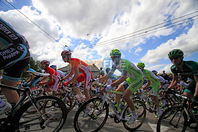 The peloton including Ivan Basso (ITA) Liquigas-Cannondale round a hairpin to climb the Cote de Lierneux during Stage 1 of the 99th edition of the Tour de France, running 198km from Liege to Seraing, Belgium. 1st July 2012.<br /> (Photo by Eoin Clarke/NEWSFILE)