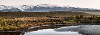 Dusk over Southern Alps with Mt. Tasman and Aoraki, Mt. Cook across Five Mile Lagoon, Westland Tai Poutini National Park, West Coast, UNESCO Wolrd Heritage Area, New Zealand, NZ