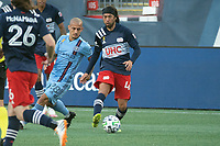 FOXBOROUGH, MA - SEPTEMBER 19: Lee Nguyen #42 of New England Revolution passes the ball during a game between New York City FC and New England Revolution at Gillette on September 19, 2020 in Foxborough, Massachusetts.