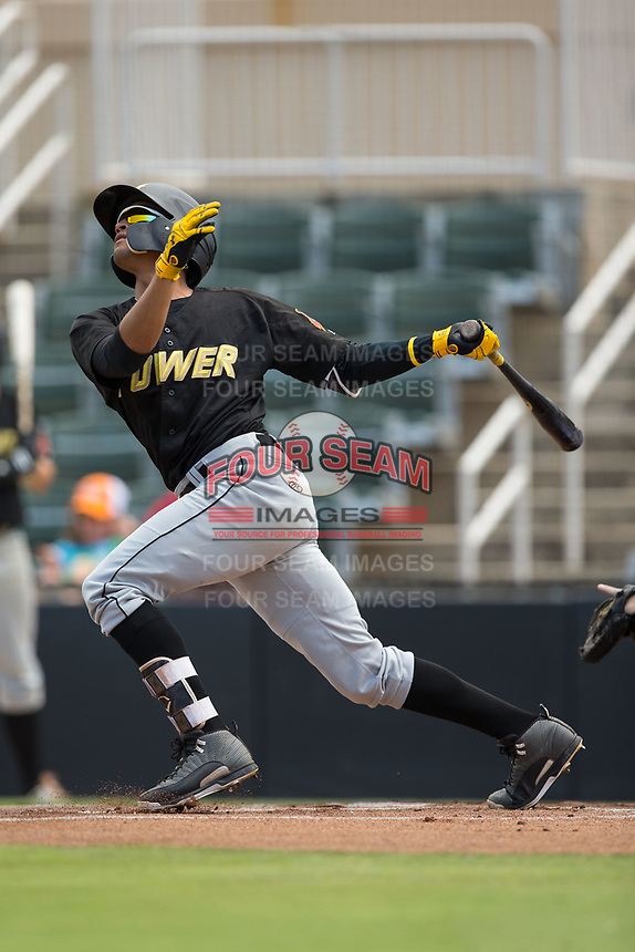 Adrian Valerio (14) of the West Virginia Power follows through on his swing against the Kannapolis Intimidators at Kannapolis Intimidators Stadium on June 18, 2017 in Kannapolis, North Carolina.  The Intimidators defeated the Power 5-3 to win the South Atlantic League Northern Division first half title.  It is the first trip to the playoffs for the Intimidators since 2009.  (Brian Westerholt/Four Seam Images)