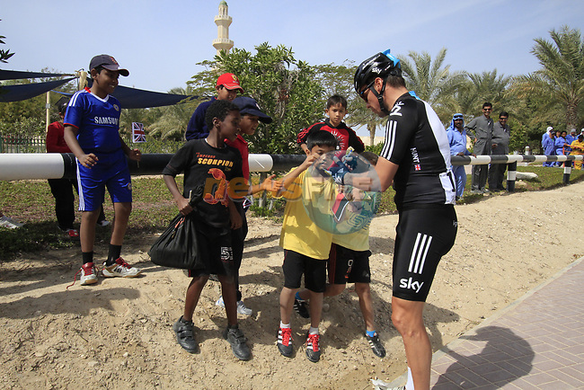 Sky Procycling rider Jeremy Hunt (GBR) signs autographs for local school children before the start of the 3rd Stage of the 2012 Tour of Qatar running 146.5km from Dukhan Souq, Dukhan to Al Gharafa, Qatar. 7th February 2012.<br /> (Photo Eoin Clarke/Newsfile)