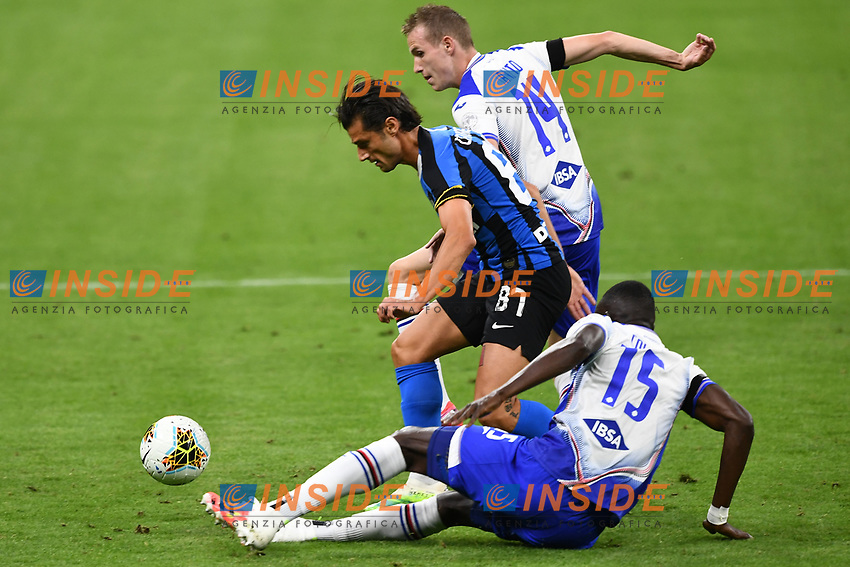 Antonio Candreva of FC Internazionale, Jakub Jankto and Omar Colley of Sampdoria compete for the ball during the Serie A football match between FC Internazionale and UC Sampdoria at Stadio San Siro in Milano ( Italy ), June 21th, 2020. Play resumes behind closed doors following the outbreak of the coronavirus disease. <br /> Photo Image/Insidefoto