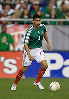 Mexico defender Carlos Salcido looks to pass. USA 2, Mexico 0, at the University of Phoenix Stadium in Glendale, AZ on February 7, 2007.