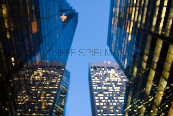 Soft Focus/Defocused view of Office Buildings on 56th Street in Midtown Manhattan, windows illuminated at dusk....Trump Tower (725 Fifth Avenue) on left, Sony Building (550 Madison Avenue, formerly the A.T. & T. Building) in the background....New York City, New York State, USA