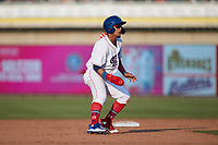 Jose Rodriguez (12) of the Kannapolis Cannon Ballers takes his lead off of second base against the Charleston RiverDogs at Atrium Health Ballpark on July 4, 2021 in Kannapolis, North Carolina. (Brian Westerholt/Four Seam Images)