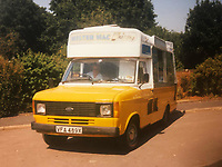 BNPS.co.uk (01202) 558833<br /> Pic: Jemma Lennie/BNPS<br /> <br /> Pictured: John's in his Mister Mac ice-cream van<br /> <br /> A much-loved ice cream seller was given a fitting send off by colleagues who followed his funeral cortege in a convoy of 10 ice cream vans. <br /> <br /> John Lennie spent over 40 years selling ice creams from his trusty van in his local community.<br /> <br /> So dedicated was he to his job that he was still doing his rounds just two days before he died at the age of 79.<br /> <br /> His daughter, Jemma Lennie, led the procession in her father's old colourful truck at his funeral in Wimborne, Dorset.