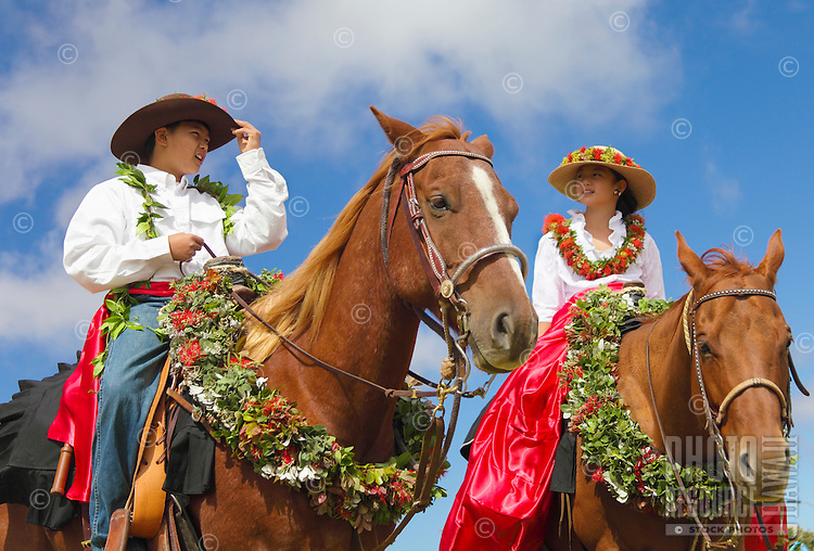 Keiki pa'u riders who are also siblings talk before start of the Waimea Paniolo Parade, Big Island.