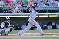 Shortstop Juan Diaz (46) of the Columbus Clippers bats in a game against the Charlotte Knights on Saturday, June 15, 2013, at Knights Stadium in Fort Mill, South Carolina. The Charlotte catcher is Bryan Anderson. Columbus won, 4-2. (Tom Priddy/Four Seam Images)