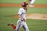 Nebraska outfielder Joe Acker (5) runs home for a score, Saturday, June 5, 2021 in the second game of the NCAA Fayetteville Regional at Baum-Walker Stadium in Fayetteville. Check out nwaonline.com/210606Daily/ for today's photo gallery. <br /> (NWA Democrat-Gazette/Charlie Kaijo)