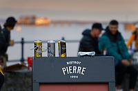 Pictured: Discarded cans of lager and cider on the Bistrot Pierre board in Mumbles. Friday 16 April 2021<br /> Re: People enjoy an evening out after Covid-19 lockdown rules were relaxed, in Swansea Bay, Wales, UK.