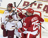 Isaac MacLeod (BC - 7), Michael Mersch (Wisconsin - 25) - The Boston College Eagles defeated the visiting University of Wisconsin Badgers 9-2 on Friday, October 18, 2013, at Kelley Rink in Conte Forum in Chestnut Hill, Massachusetts.