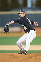Wake Forest Demon Deacons relief pitcher Aaron Fossas (18) in action against the Missouri Tigers at Wake Forest Baseball Park on February 22, 2014 in Winston-Salem, North Carolina.  The Demon Deacons defeated the Tigers 1-0.  (Brian Westerholt/Four Seam Images)