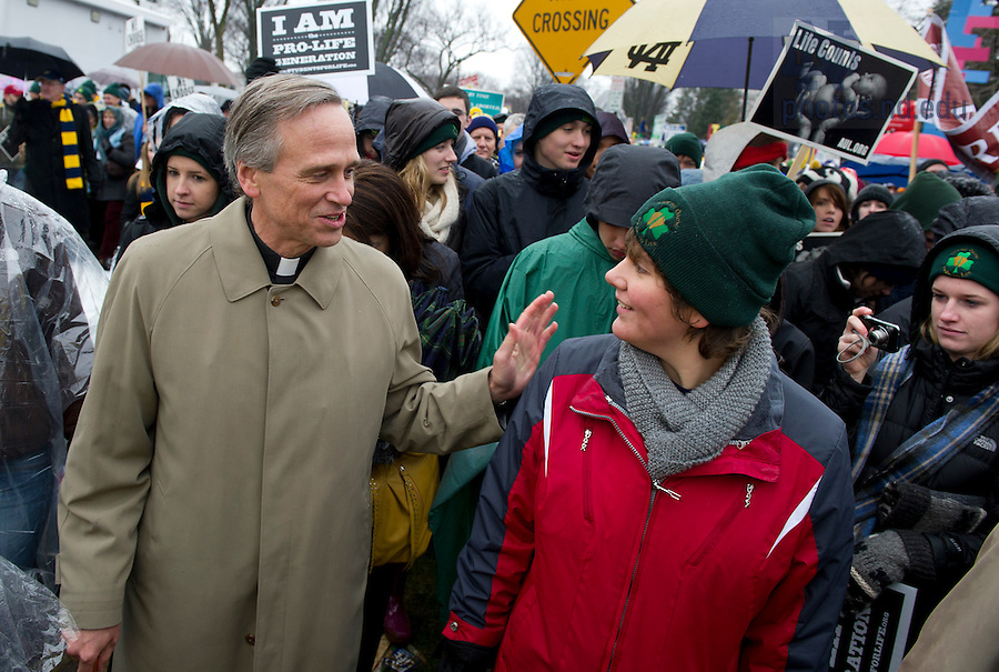 January 23, 2012; Fr. John Jenkins C.S.C., walks with Notre Dame students at the 2012 March for Life in Washington, D.C. Photo by Barbara Johnston/University of Notre Dame