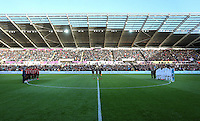 Manchester City, Swansea City players, match officials and army cadets observe a minute's silence prior to the Premier League match between Swansea City and Manchester United at The Liberty Stadium, Swansea, Wales, UK. Sunday 06 November 2016