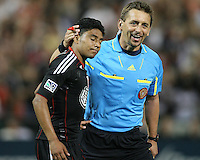 Cristian Castillo #12 of D.C.United with referee Alex Prus during an MLS match against the Kansas City Wizards at RFK Stadium on May 5 2010, in Washington DC. United won 2-1