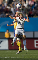 USA midfielder (17) Lori Chalupny goes up for a header against Sweden midfielder (5) Caroline Seger during their Group B first round game at the 2007 FIFA Women's World Cup at Chengdu Sports Center Stadium in Chengdu, China, on September 14, 2007. The United States (USA) defeated Sweden (SWE), 2-0.