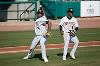 Charleston RiverDogs relief pitcher Angel Felipe (28) makes a throw to first base as third baseman Abiezel Ramirez (2) looks on during the game against the Augusta GreenJackets at Joseph P. Riley, Jr. Park on June 27, 2021 in Charleston, South Carolina. (Brian Westerholt/Four Seam Images)