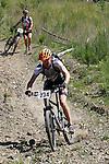 Nick Reeve (234) kicks up some dust.  Mammoth Adventure MTB Ride, Nelson<br /> Photo: Marc Palmano/shuttersport.co.nz