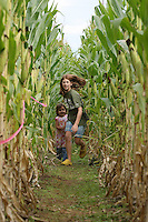 Kids run thru a corn maze in Greene County, Va.