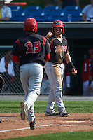 Batavia Muckdogs outfielder Alex Fernandez (46) waits to congratulate Erwin Almonte (25) after hitting a home run during a game against the Auburn Doubledays on September 7, 2015 at Falcon Park in Auburn, New York.  Auburn defeated Batavia 11-10 in ten innings.  (Mike Janes/Four Seam Images)