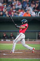 Billings Mustangs right fielder Satchel McElroy (14) follows through on his swing during a Pioneer League game against the Idaho Falls Chukars at Melaleuca Field on August 22, 2018 in Idaho Falls, Idaho. The Idaho Falls Chukars defeated the Billings Mustangs by a score of 5-3. (Zachary Lucy/Four Seam Images)