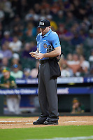 Home plate umpire Jason Milsap updates his lineup card during the NCAA baseball game between the LSU Tigers and the Baylor Bears in game five of the 2020 Shriners Hospitals for Children College Classic at Minute Maid Park on February 28, 2020 in Houston, Texas. The Bears defeated the Tigers 6-4. (Brian Westerholt/Four Seam Images)