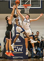 WASHINGTON, DC - JANUARY 29: Maceo Jack #14 and Chase Paar #3 of George Washington defend gainst Luka Brajkovic #35 of Davidson during a game between Davidson and George Wshington at Charles E Smith Center on January 29, 2020 in Washington, DC.