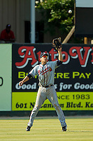 Rome Braves left fielder Joey Meneses (34) catches a fly ball during the South Atlantic League game against the Kannapolis Intimidators at CMC-Northeast Stadium on June 16, 2013 in Kannapolis, North Carolina.  The Intimidators defeated the Braves 6-4.   (Brian Westerholt/Four Seam Images)