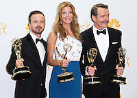 LOS ANGELES, CA, USA - AUGUST 25: Actors Aaron Paul, Anna Gunn and Bryan Cranston, winners of Outstanding Drama Series Award, Outstanding Lead Actor in a Drama Series Award, Outstanding Supporting Actor in a Drama Series Award and Outstanding Supporting Actress in a Drama Series for 'Breaking Bad' pose in the press room at the 66th Annual Primetime Emmy Awards held at Nokia Theatre L.A. Live on August 25, 2014 in Los Angeles, California, United States. (Photo by Celebrity Monitor)