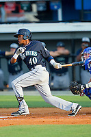 Jesus Ugueto (40) of the Pulaski Mariners follows through on his swing against the Burlington Royals at Burlington Athletic Park on June20 2013 in Burlington, North Carolina.  The Royals defeated the Mariners 2-1 in 13 innings.  (Brian Westerholt/Four Seam Images)