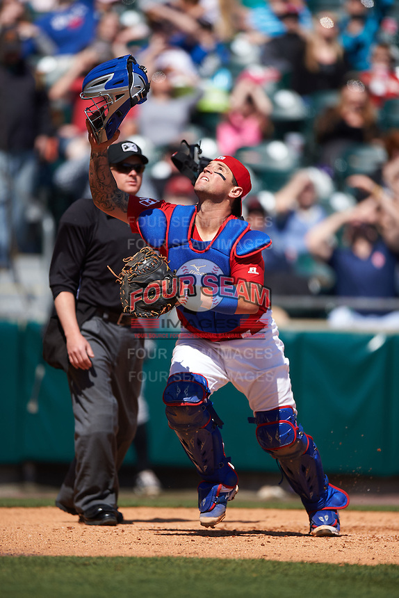 Buffalo Bisons catcher Sean Ochinko (9) makes a play on a foul ball pop up in front of umpire Ian Fazio during a game against the Louisville Bats on May 2, 2015 at Coca-Cola Field in Buffalo, New York.  Louisville defeated Buffalo 5-2.  (Mike Janes/Four Seam Images)