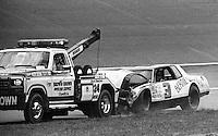 ARCA car of Ronnie Bates and Bernie Robidart on hook wrecker after crash in the Dixie 300 ARCA Race at Atlanta International Raceway in Hampton, GA on March 16, 1986.   (Photo by Brian Cleary/www.bcpix.com)