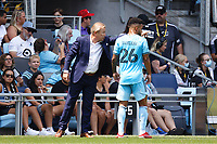 ST PAUL, MN - JULY 18: Adrian Heath provides instruction to DJ Taylor #26 of Minnesota United FC during a game between Seattle Sounders FC and Minnesota United FC at Allianz Field on July 18, 2021 in St Paul, Minnesota.