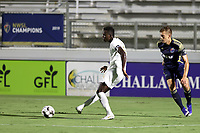 CARY, NC - AUGUST 01: Rudolf Mensah #14 passes the ball away from Sam Brotherton #5 during a game between Birmingham Legion FC and North Carolina FC at Sahlen's Stadium at WakeMed Soccer Park on August 01, 2020 in Cary, North Carolina.