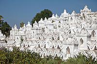 Myanmar, Burma.  Mingun, near Mandalay.  Hsinbyume Paya Stupa, completed 1816.  Seven wavy terraces around the stupa represent the seven mountain ranges around Mt. Meru, center of the universe in Hindu and Buddhist cosmology.