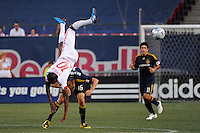 Macoumba Kandji (10) of the New York Red Bulls goes over the top of Gregg Berhalter (16) of the Los Angeles Galaxy on a header. The Los Angeles Galaxy defeated the New York Red Bulls 3-1 during a Major League Soccer match at Giants Stadium in East Rutherford, NJ, on July 16, 2009.