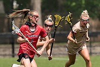 NEWTON, MA - MAY 14: Maggie Fort #1 of Fairfield University brings the ball forward as Cara Urbank #26 of Boston College defends during NCAA Division I Women's Lacrosse Tournament first round game between Fairfield University and Boston College at Newton Campus Lacrosse Field on May 14, 2021 in Newton, Massachusetts.
