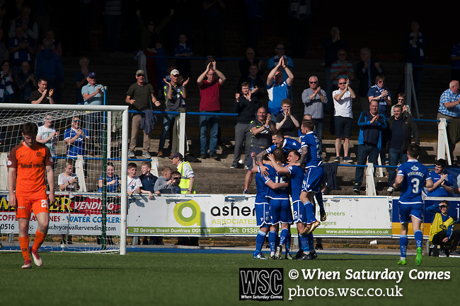 Home players celebrating their team's third goal scored by Connor Murray at Palmerston Park, Dumfries as Queen of the South hosted Dundee United in a Scottish Championship fixture. The home has played at the same ground since its formation in 1919. Queens won the match 3-0 watched by a crowd of 1,531 spectators.