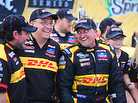 May 1, 2011; Baytown, TX, USA: NHRA funny car driver Jeff Arend (right) celebrates with his crew after winning the Spring Nationals at Royal Purple Raceway. Mandatory Credit: Mark J. Rebilas-