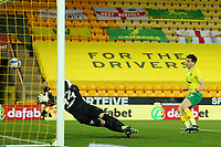 6th April 2021; Carrow Road, Norwich, Norfolk, England, English Football League Championship Football, Norwich versus Huddersfield Town; Jordan Hugill of Norwich City scores past Joel Pereira of Huddersfield Town for 7-0 in the 78th minute