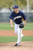 Mark Rogers #37 of the Milwaukee Brewers participates in pitchers fielding practice during spring training workouts at the Brewers complex on February 18, 2011  in Phoenix, Arizona. .Photo by Bill Mitchell / Four Seam Images.