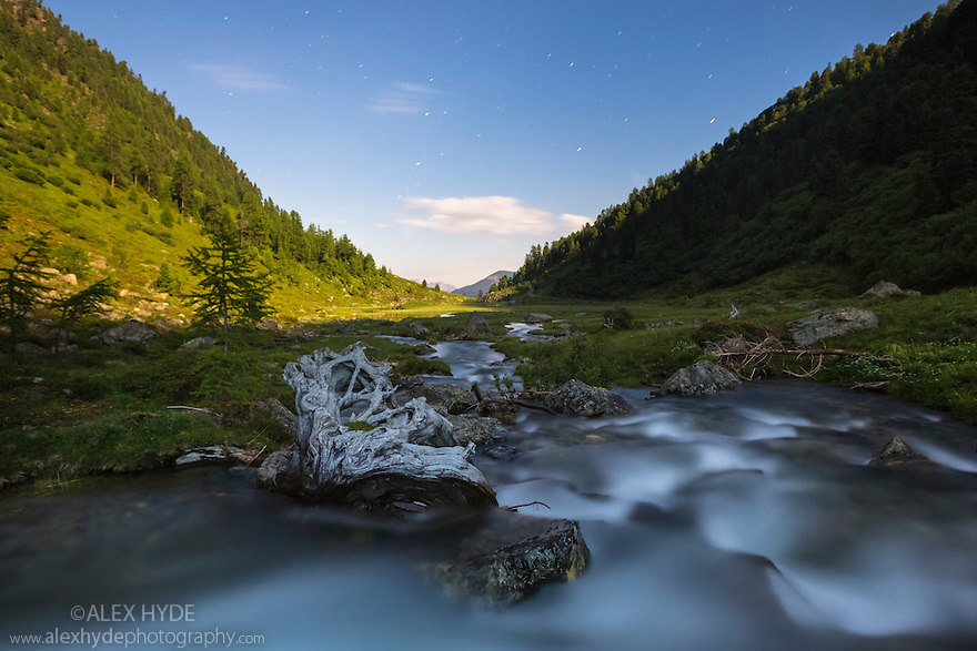 Alpine landscape at night, illuminated by moonlight. Nordtirol, Austrian Alps. July.