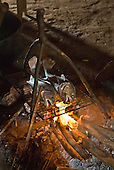 Xingu Indigenous Park, Mato Grosso State, Brazil. Aldeia Afukuri (Kuikuro). Fish cooking over an open fire.